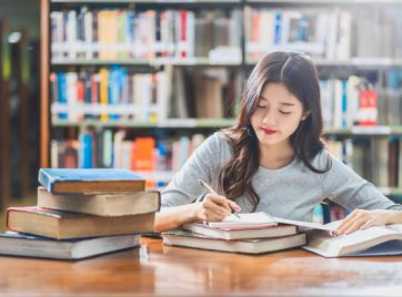 asian-young-student-reading-doing-homework-library-university_41418-3506